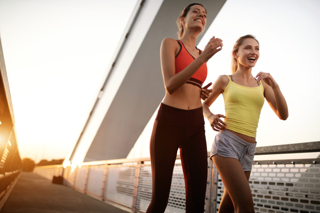Beautiful women working out in a city. Running, jogging, exercise, people, sport concept